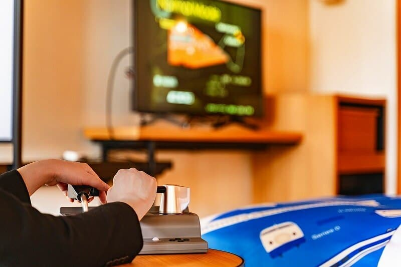 In the driver's seat with the two-handle Master Controller